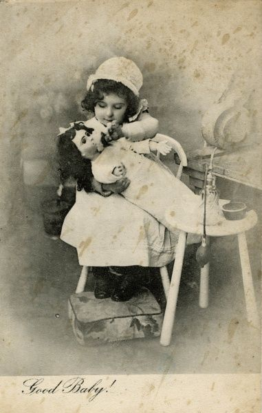 Good Baby -- a little girl washing her doll. Date: early 20th century