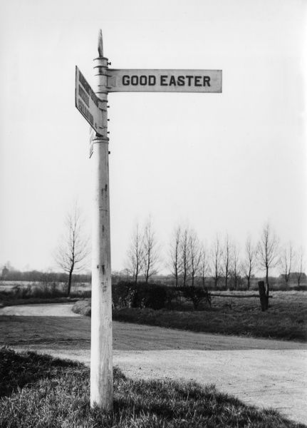 'Good Easter', a signpost to a village in Essex, England, the village of 'Good Wishes'. Date: 1950s