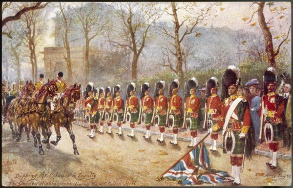 A detachment of Gordon Highlanders dip the colours to passing royalty near Buckingham Palace on Constitution Hill