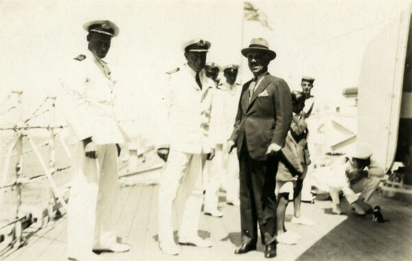 Governor of Arica standing with the Captain and the Commander of a Chilian Naval vessel. Date: circa 1920s