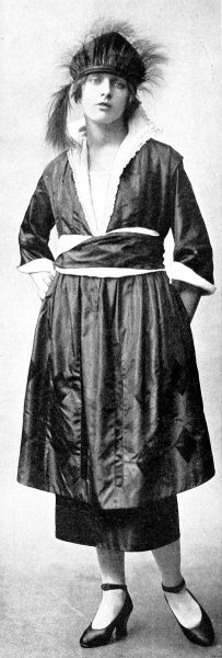 A black taffeta gown with a sash and lining of snow white crepe de chine. The head dress was made from taffeta trimmed with osprey and paradise