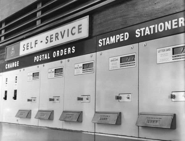 The self-service section of the General Post Office at Exeter offering change, postal orders and stamped stationery
