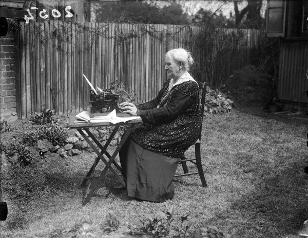 88-year-old Mrs Caroline Blore, using her own typewriter in her back garden