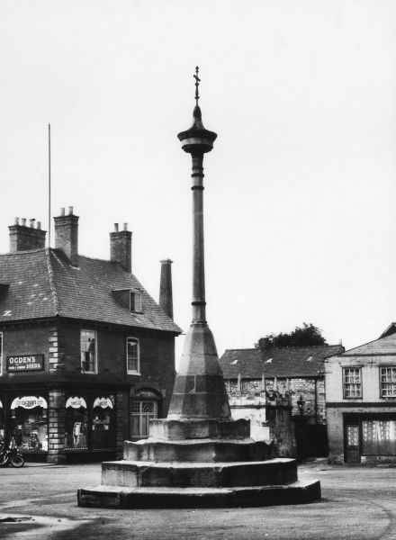 The fine old Market Cross in the Market Square of Grantham, Lincolnshire, England. Date: 1940s