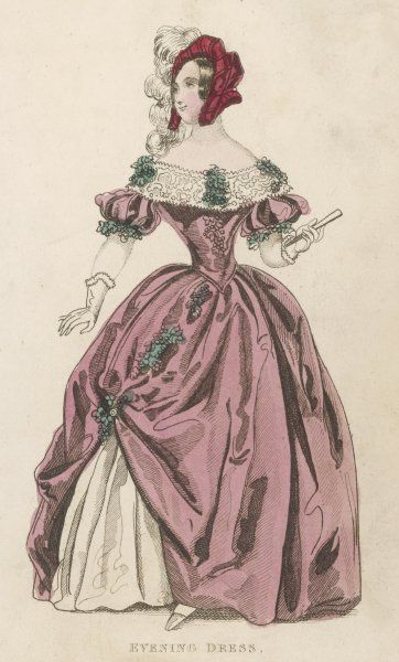 Dress adorned with bunches of grapes: with a lace falling tucker, pointed waist & short puffed sleeves. The skirt is pinned up on one side. Worn with a plumed tudor style hat