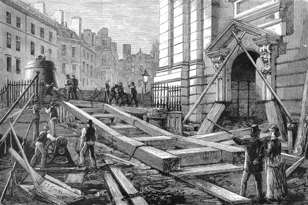 Engraving showing the wooden 'slipway' used to manoevre a new 'Great Bell' (on left) into St. Paul's Cathedral (on right), London, in 1882
