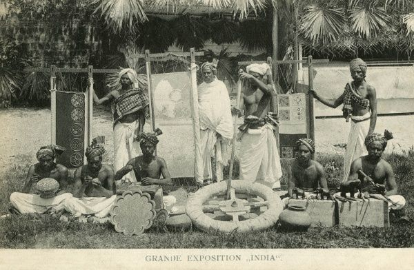 Great Indian Exhibition (Grande Exposition India), held in Paris, showing nine Indian men with their arts and crafts. Date: 1902