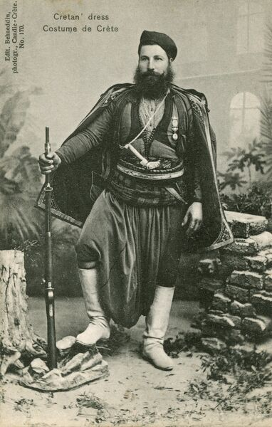 Gentleman wearing traditional Cretan costume holding a rifle