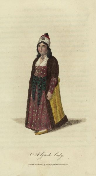 A Greek Lady. She is wearing an elaborate dress and hat and wearing jewellery