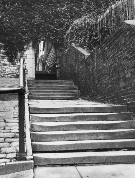 A glimpse of Greestone Stairs, a steep flight of steps leading up to Lincoln Cathedral, England