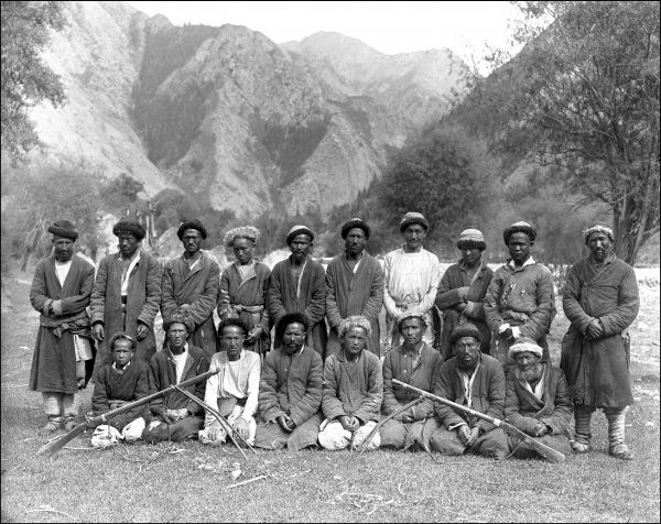 A group of local men, probably travel guides, in the mountains of Kashgar, western China. Photograph by Ralph Ponsonby Watts