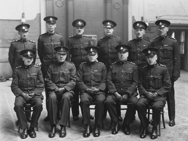 A group of eleven Special Constables of the Metropolitan Police, London, pose for their photograph. They are all in uniform, and some have decorations from the First World War above their left pocket