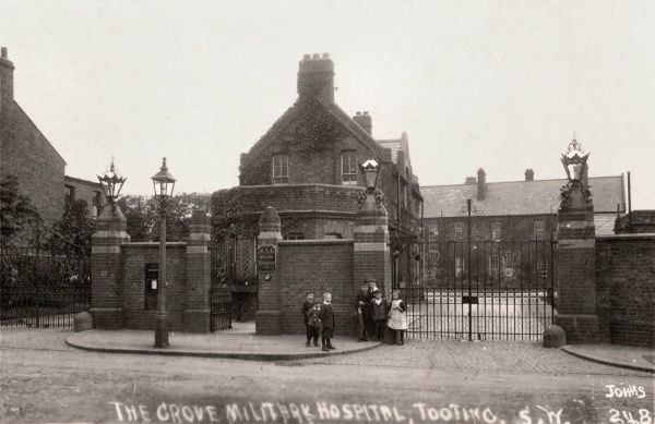 Children stand at the gates of the Grove Hospital at Tooting Grove, Surrey (now South London) during its First World War service as a military hospital