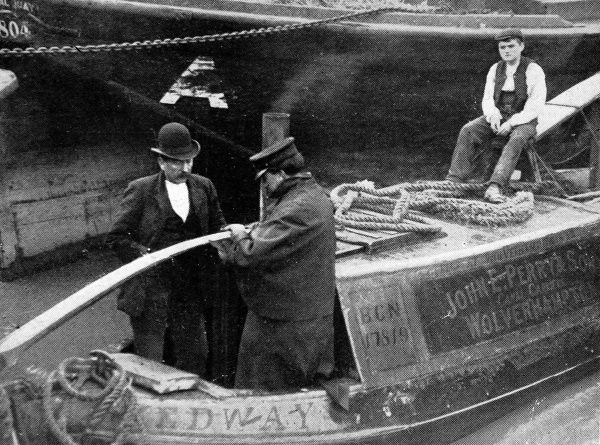 A photograph showing the authorities inspecting canal barges. As a result of a serious outbreak of cholera in Russia, European countries took stringent measures to prevent the spread of the disease