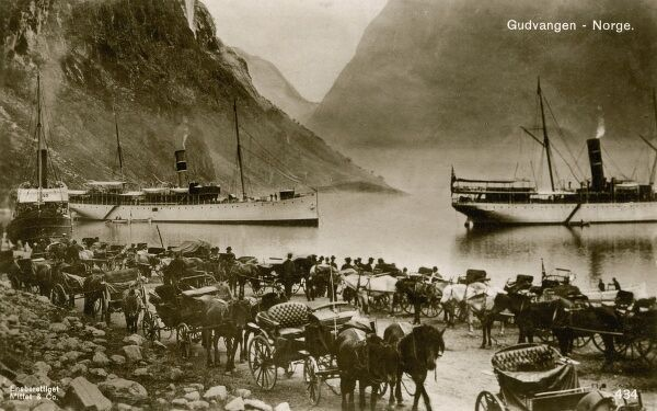 Gudvangen, Norway - open cabs await the disembarking steamboat tourists