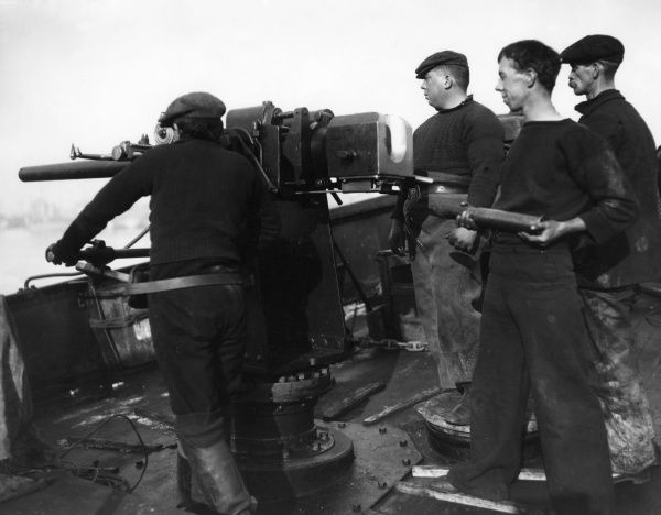A gun crew drilling on the British trawler HM Principal during the First World War. Date: 1916