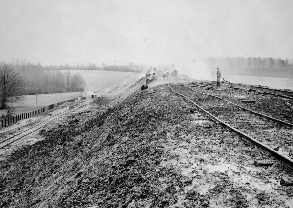 Navvies working on a Great Western Railway line embankment, somewhere in South Wales. The navvy hut can be seen in the distance on the left