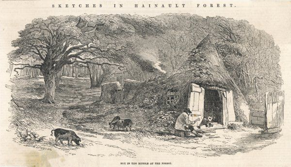 A man cuts wood by the entrance to his hut in the middle of Hainault Forest