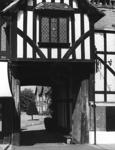 A black and white half- timbered courtyard gateway at Canterbury, Kent, England. Date: 16th century
