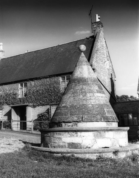 The ancient conical Market Cross at Hallaton, Leicestershire, England. Date: 1950s
