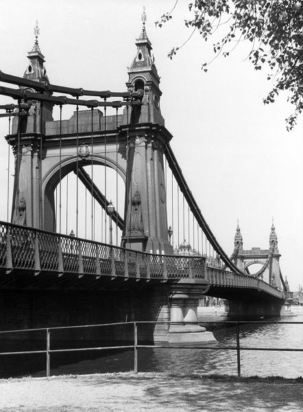 Hammersmith Bridge, west London, was the first suspension bridge over the River Thames. It was designed by noted civil engineer Sir Joseph Bazalgette. Date: completed 1887