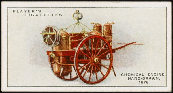 A hand-drawn chemical fire engine employed for fire extinction about 1878. The chemicals were held in copper cylinders mounted at the front of the vehicle