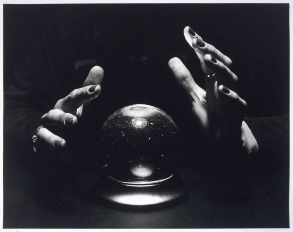 A spooky photograph of a crystal ball and a woman's hands