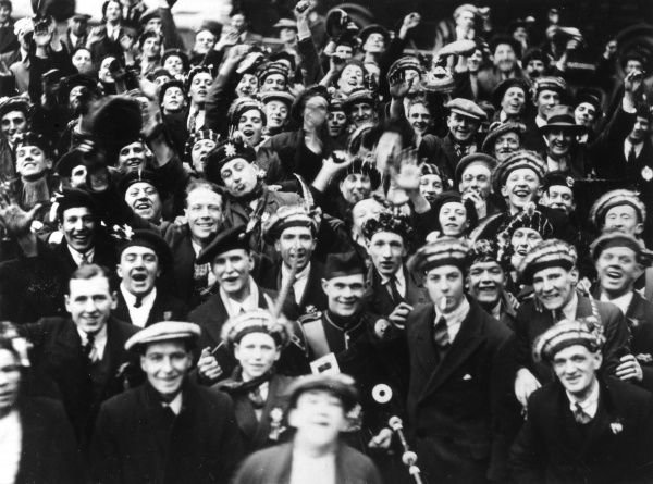 A happy crowd of Scottish men. Date: 1930s