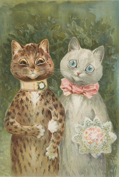 A feline bride and groom stand proudly having just got hitched