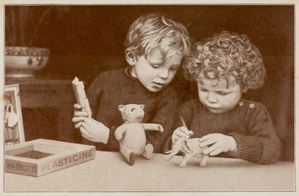 A boy and a girl making models out of Harbutt's plasticine