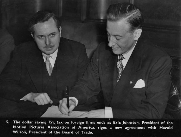 Harold Wilson, President of the Board of Trade, and Eric Johnston, President of the Motion Pictures Association of America, signing a new agreement which put an end to a 75% tax saving on film imports