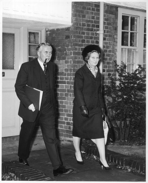 James Harold Wilson (1916-1995), Baron Wilson of Rievaulx, British Labour leader and Prime Minister, pictured with his wife leaving their home in Hampstead Garden Suburb for Parliament in 1963 while still leader of the Opposition