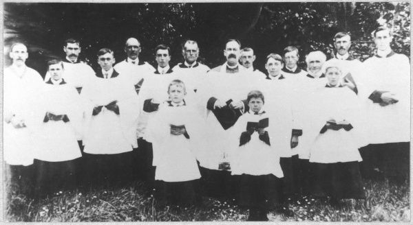HARRY BULL, rector of Borley from 1892 to 1927, with the church choir