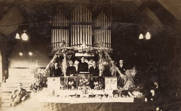 A Harvest Festival display at the United Methodist Church, Whitwood Mere, near Castleford, Yorkshire. Included in the photo is the organist, Bower M Stoker, and a lay preacher, Job Harling. Date: 20 September 1925