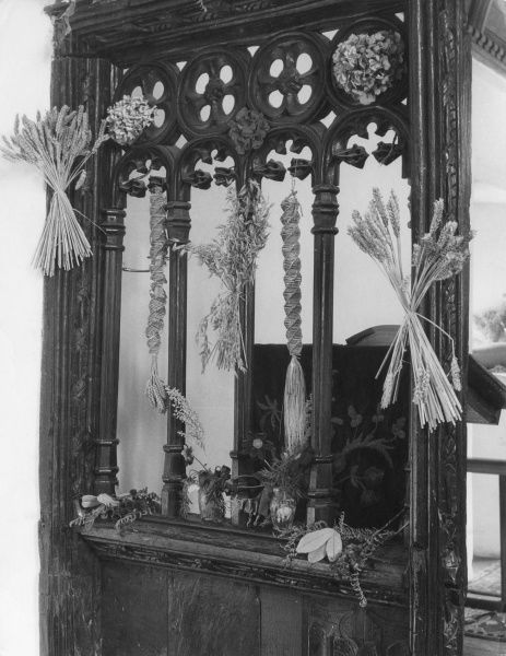 A Harvest Festival screen decorated with Corn Dollies at 'England's Smallest Church' at Culbone, Somerset. Date: August 1963