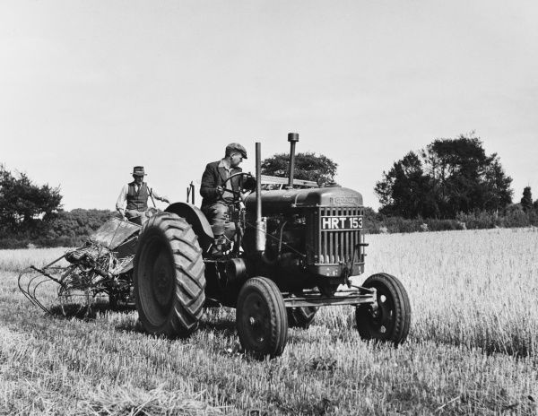 Havesting barley on a farm in Suffolk, England, using a Fordson tractor