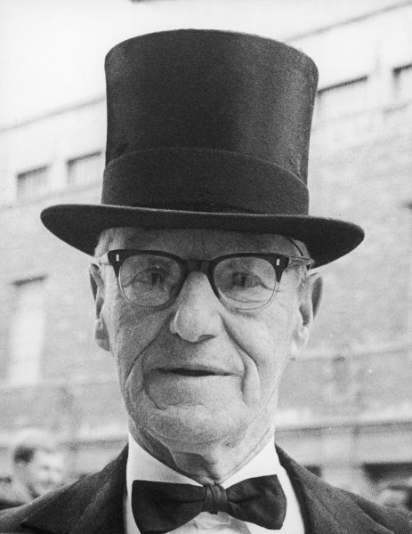 An elegant, elderly gentleman wearing a bow-tie and top hat. Date: circa 1960