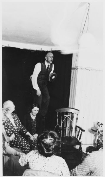 A F Hatcher, about whom little is known, levitates at a seance, holding a luminous tambourine enabling photographer Harold T Brown to focus his Kodak correctly
