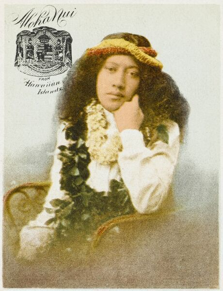 A very early postcard depicting a Hawaian girl, with floral garlands around her neck and head
