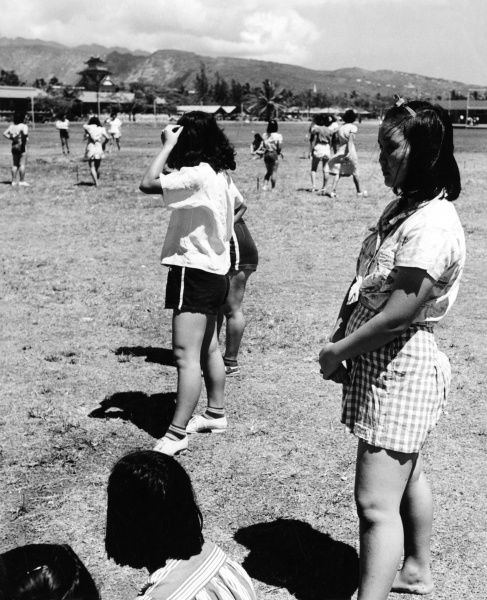 Japanese Hawaiian schoolgirls in the grounds of McKinley High School, Honolulu, Hawaii, Pacific Islands, U.S.A. Date: 1940s