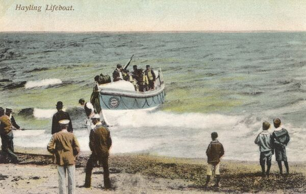 Hayling Island Lifeboat returning from a rescue; pulled up onto the beach. Date: 1906