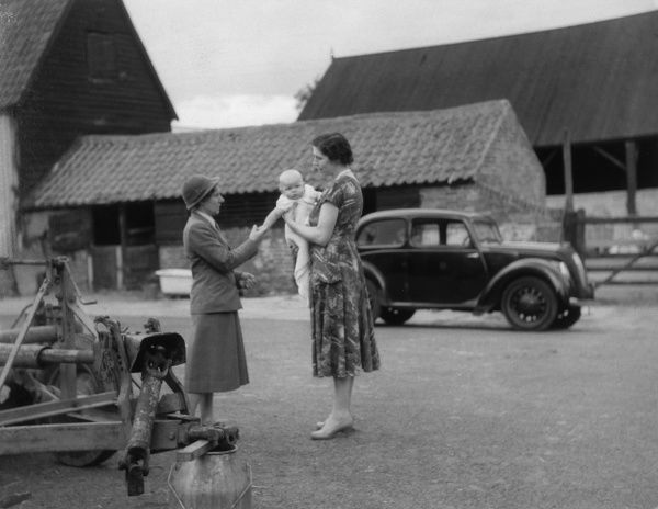 A health visitor visits a mother and her baby on their farm (near Colchester) Date: 1950s