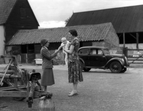 A health visitor on a visit to a farmer's wife and her baby on a farm near Colchester, Essex Date: 1950s