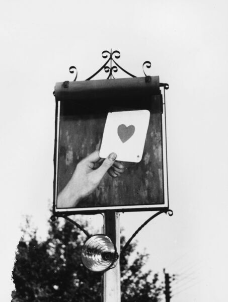 The striking inn sign of 'The Heart in Hand' at Bourne End, near High Wycombe, Buckinghamshire, England