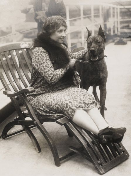Helen Keller (1880-1968) born blind deaf mute. Thanks to her governess she overcame these handicaps, studied and created in 1921 the American Foundation for the Blind. Pictured here on the S.S. Cleveland with her Great Dane dog, given to her by Robert Ltuz