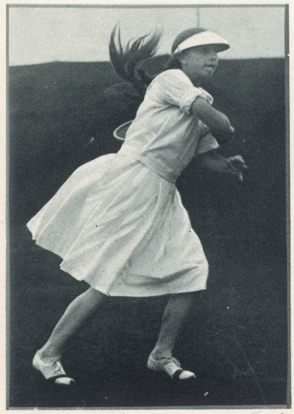 Helen Wills Moody (1905 - 1998), American tennis player and eight times Wimbledon champion, pictured as a young girl playing in the semi final round of the Junior Championship at Forest Hills and wearing the famous eye shade or sun visor which