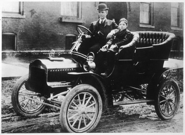 Henry Ford, the American motor manufacturer, with his son Edsel in one of the many versions of the Model T