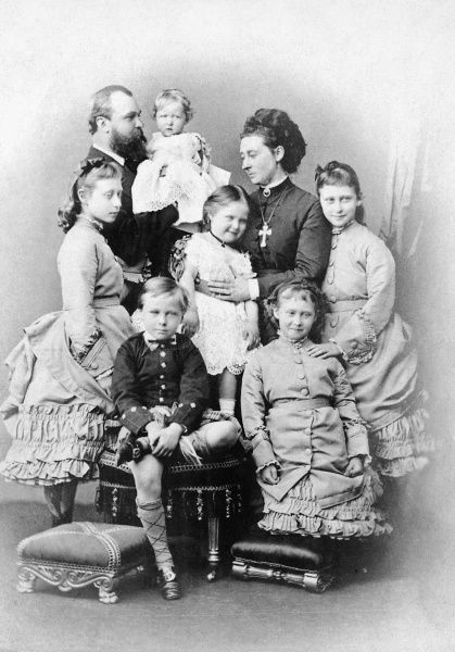 Princess Alice of Great Britain, third child and second daughter of Queen Victoria, later Grand Duchess of Hesse and by Rhine (1843 -1878), pictured with her husband, Ludwig (Louis) IV, Grand Duke of Hesse and her children. Clockwise from far left