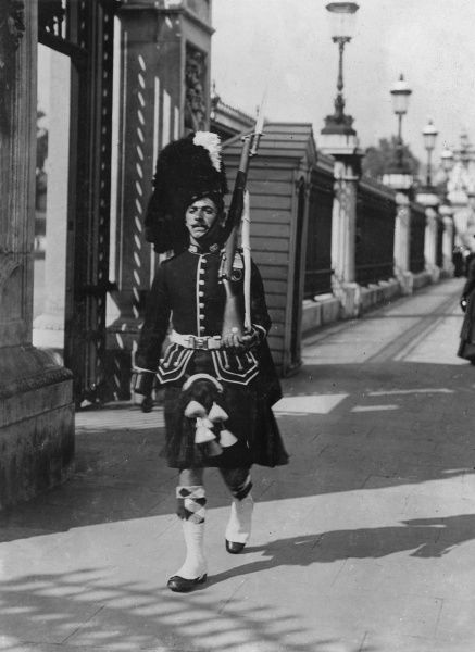 A Highland Guard on duty at Buckingham Palace -- the first time a kilted regiment had done duty at the Palace, the regular Guards being away on manoeuvres