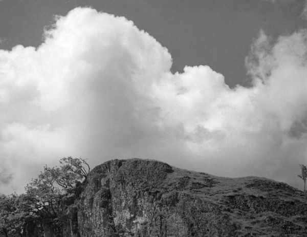 Clouds above a hilltop. Date: 1950s